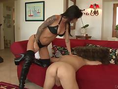 Tattooed cowgirl jams her new stud's anal with a strap on dildo hardcore