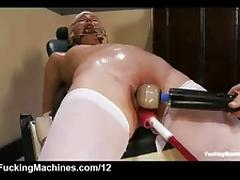 Double gagged blonde machine fucked