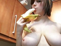 Louisa sucks off a banana wearing yellow lingerie in the kitchen porn tube video