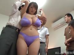 Long haired Japanese bitch in bra exposes her giant tits to these horny studs