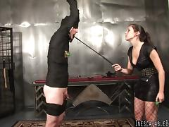 A masked man enjoying a hardcore fetish session in his mistresses torture chamber