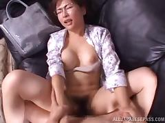 Very sexy Japanese babe in glasses enjoys this dong banging her hairy muff in POV porn tube video