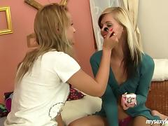 Slim and long legged teen lesbian blondes stimulating their cunnies
