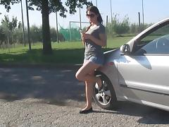 Foot fetish girl teasing and showing off her legs in the car