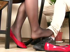 Playing footsie under the table with a girl in pantyhose