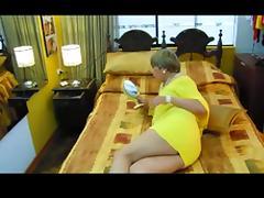Crossdresser in yellow eats two cocks in turn