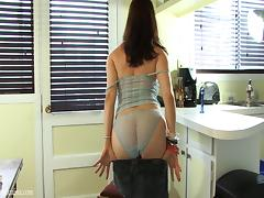 Lingerie-clad brunette with glasses playing with her wet pussy
