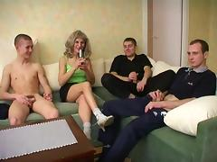 A group of younger guys gangbangs a horny, slutty granny