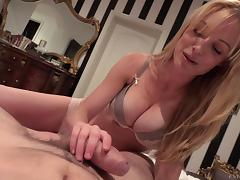 Blondie woman with big boobs giving a blowjob and titjob