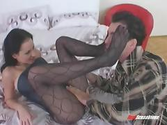 Taking off her sexy black stockings to ram her twat