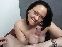 Chubby cougar with glasses playing with a stranger's cock