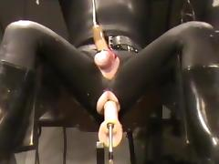 Full rubber, machine screwed and milked porn tube video