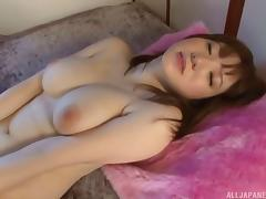 Glamorous Asian solo model stroking her cunt with a vibrator till orgasm