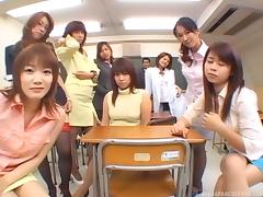 A full classroom of Asian coeds get their teacher off