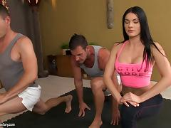 Yoga babe with big fake tits turns them on and gets double fucked