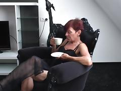 Slim redhead granny rubbing and fingering her aching cunt