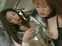 Two Japanese lesbians fuck with a strapon porn tube video