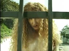 Redhead bitch fondles her cunt and urinates at the gates nude