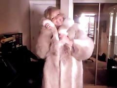 Sexy Woman showing off her Wolf Fur Coat II