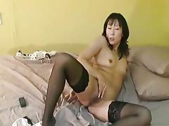 Mature asian masturbating