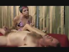 Slut jerks off guys dick on massage table