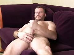 Horny gay hunk masturbates on an interview tube porn video