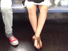 Candid girl feet in sandals