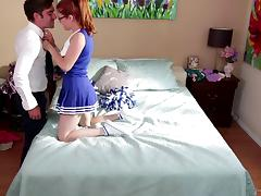 A horny redheaded cheerleader gets some dick from an older guy