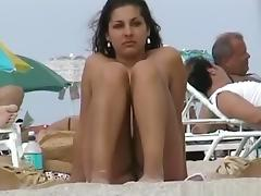 A voyeur capturing pussies and tits of girls on a nude beach tube porn video