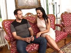 Sassy brunette sucks on a massive cock pending a hardcore bonking on the couch
