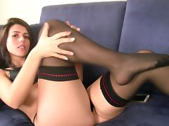 After showing off her stocking feet she takes the stockings off