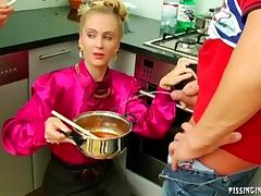 Dirty European blondes using a man's piss in the kitchen