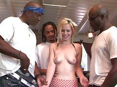Mini-skirt clad blonde with a hot ass enjoying an interracial gangbang