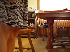 Milf rides her husband upskirt on a chair in the kitchen