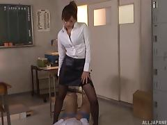 Teacher in a sexy leather skirt sits on a hard dick
