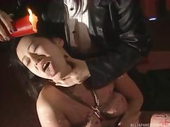 Bondage loving Japanese MILF has hot wax poured on her tits