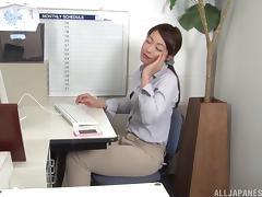 Clothed Japanese woman sucking a colleague's cock in the office
