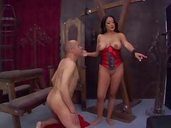 A mistress punishes her slave then strokes his cock