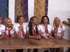 Uniform-clad tranny with long blonde hair and big boobs enjoying a hardcore gangbang