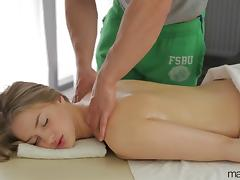 She enjoys her masseuse's hands and his impressive cock