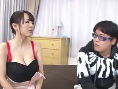Very busty Asian babe jerks a guy off all over her big melons porn tube video