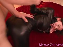 Japanese milf in leather sucking on dick