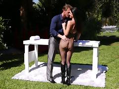 Kate blows the giant cock under a masseuse table then rides on it roughly in an outdoor orgy