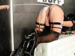 Dark haired girl in a short skirt gets a surprise at a gloryhole