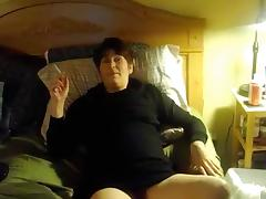 Mature chubby wife masturbates and smokes in bed on cam