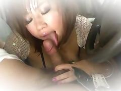 Neiro Suzuka blows on a big dick while in the car porn tube video
