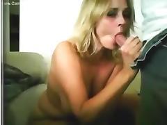 Big boobed blonde girl gives her man a blowjob, titjob and sucks his balls