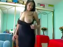 Busty and marvelous brunette demonstrates her juicy saggies