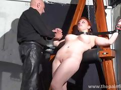Swedish amateur submissive Vicky Valkyries dungeon bondage and whipping post spanking of chubby en###d redhead in bdsm