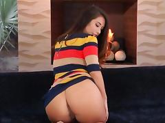 Brunette is displaying her pussy to us in this video